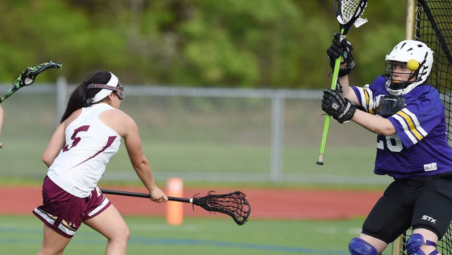 Arlington's Danielle Heady shoots to score on Clarkstown North's goalie, Ciara Frawley during Wednesday's game at Arlington.