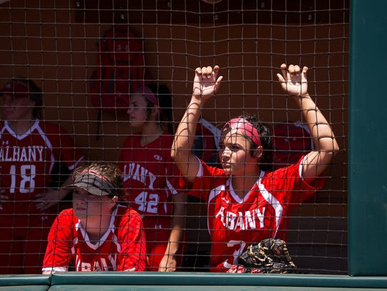 Albany High School players wait in their dugout before their 2A state semifinal game against Bells High School at McCombs Field in Austin. Albany was making its third state appearance under coach Jimmy Fuentes.