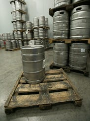 Pictured are dozens of kegs in a cooler room at Premier