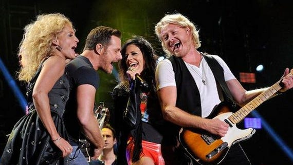 Frederick Breedon / WireImage Kimberly Schlapman, Jimi Westbrook, Karen Fairchild and Phillip Sweet of Little Big Town perform at LP Field at the 2014 CMA Festival in Nashville.