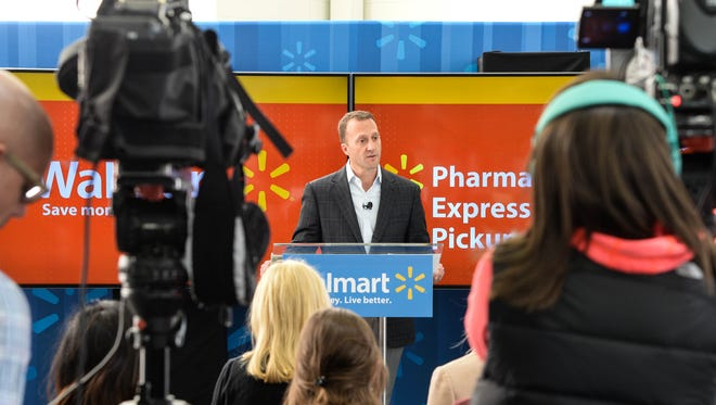 Walmart executive Daniel Eckert details the upgrades to the Walmart app during a visit to the North Bergen store on Monday.