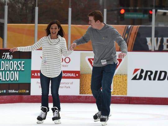 Emily and Stephen Garrett ice skate at Bridgestone Winter Park, which opened Saturday Dec. 12, 2015. The outdoor ice skating rink was created as a focal point for NHL All-Star festivities.