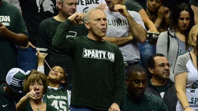 Michigan State fans cheer during the second half of the first round against the Middle Tennessee Blue Raiders on March 18, 2016, in St. Louis, Mo.