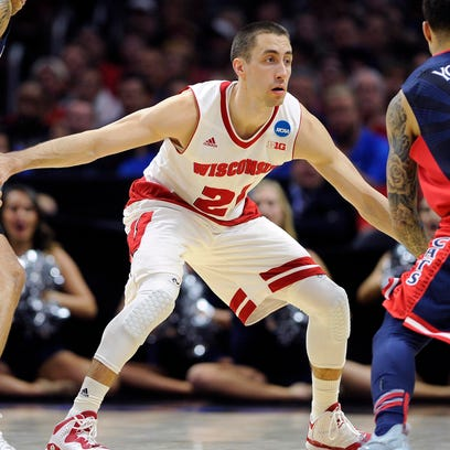 Wisconsin  guard Josh Gasser (21) says just getting to the Final Four is not enough this time.
