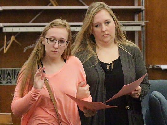 Breanna Mikula, left, and Chisty Tuchel, right, leave proceedings in Sheboygan County Circuit Court, Tuesday, October 24, 2017, in Sheboygan, Wis. Tuchel and Mikula are involved in case where 36 dogs were seized in the Town of Wilson last June.