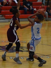 Aaliyah Chapman looks to pass during the game last Friday night.