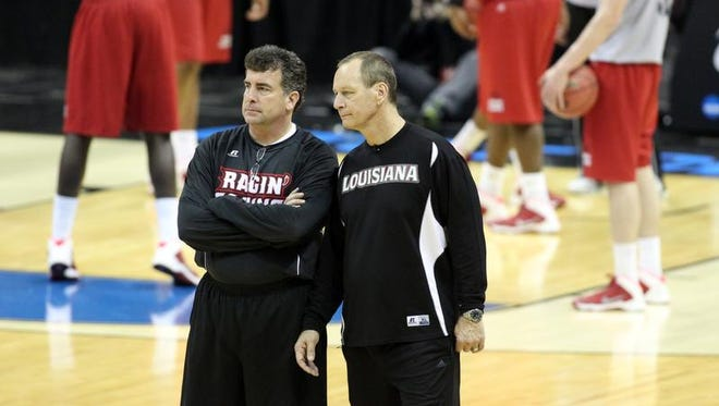 UL basketball operations director Mike Murphy, left, stands with head coach Bob Marlin during a practice before the Cajuns' 2014 NCAA Tournament game in San Antonio. UL coach Bob Marlin, right, and Mike Murphy, director of basketball operations at UL, watch as players practice at the AT&T Center in San Antonio on Thursday.
