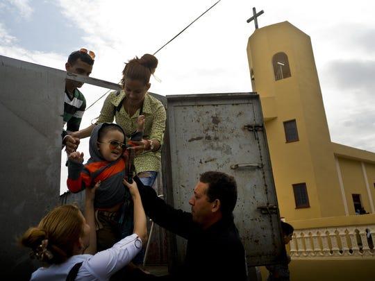 Faithful arrive for the consecration Mass of the Sagrado Corazon de Jesus Catholic church or Sacred Heart, in Sandino, Cuba, Saturday, Jan. 26, 2019.