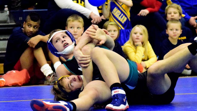 Moeller's Cooper Graves (bottom) is all tied up with no place to go but a pinfall as Mason's Christopher Donathan takes the victory for the Comets.
