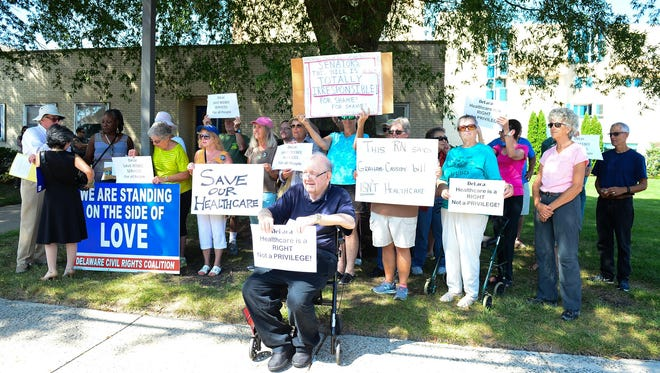 The Delaware Alliance for Community Advancement gathered in front of Beebe Medical Center in a group protest of the Graham-Cassidy Bill on Sept. 25 in Lewes.