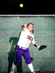 Opelousas Catholic left fielder throws the ball from