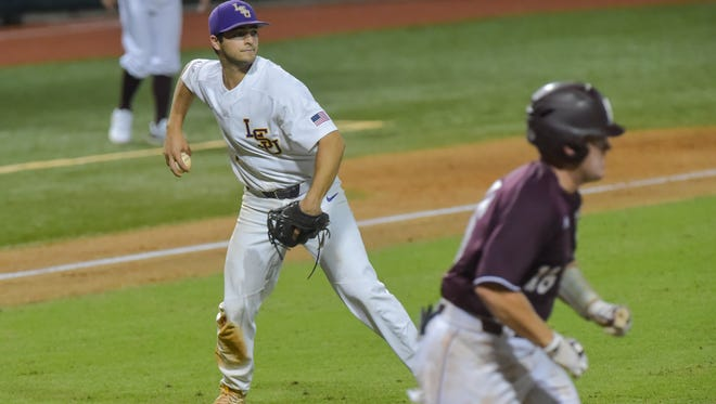 Josh Smith throws the runner out at first as Mississippi State takes on LSU in the NCAA Super Regional at Alex Box Stadium in Baton Rouge, LA.- Saturday, June 10, 2017.