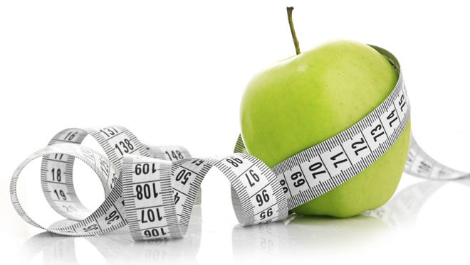 Day-to-day fluctuations in weight aren't necessarily an indication of how your weight-loss program is going.