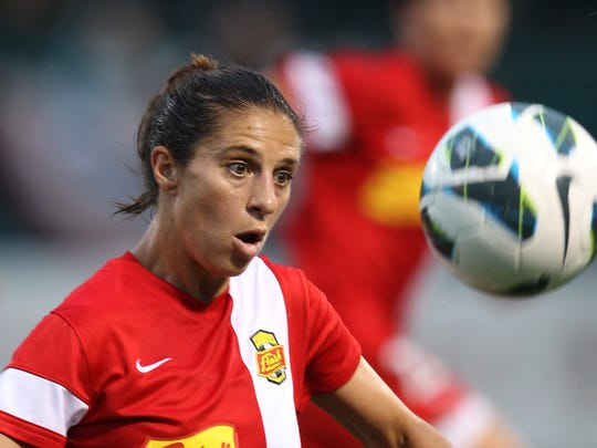 File photo: Flashes Carli Lloyd looks to control the ball.