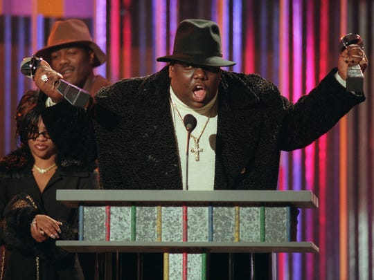 The Notorious B.I.G.  clutches his Billboard Music Awards in New York, on  Dec. 6, 1995.