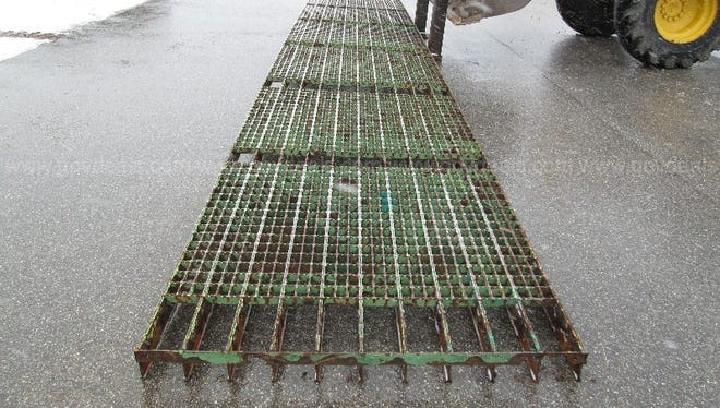 The Mackinac Bridge Authority is auctioning two-ton sections of the original steel deck grating