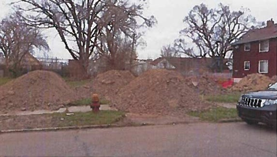 Den-Man is accused of illegal dumping on a woman's property,  adjacent to an approved demolition site on the city's west side.