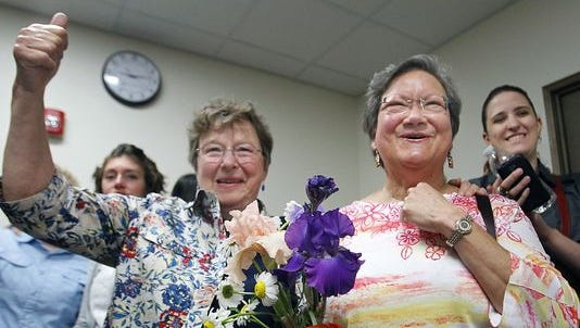 A federal court slammed Wisconsin's legal arguments for its gay marriage ban in a unanimous ruling. In this file photo, a Brown County couple get news they would receive a marriage license.