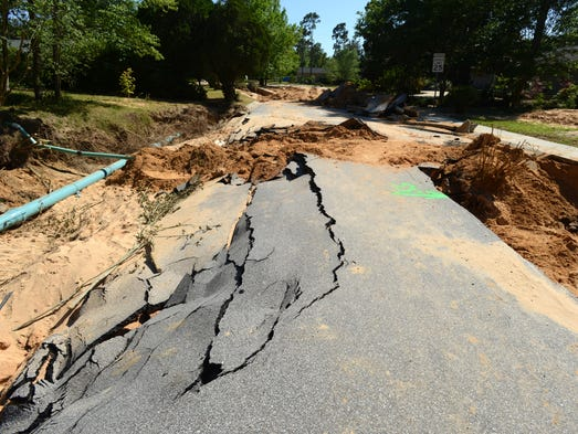 Area roads, like Peidmont Road, have been badly damaged by last week's flood.