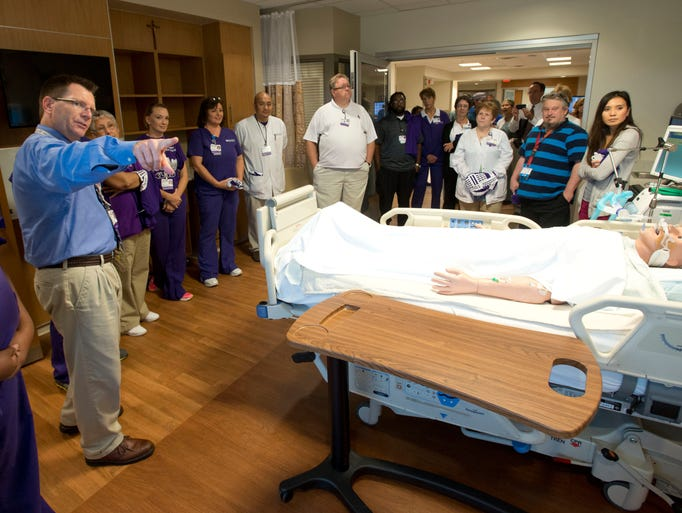 Sacred Hearth Respiratory Care Manager, Marty Robbins, left, gives a group of hospital employees a tour of the new patient care facilities in the new Bayou Tower. The new wing features state of the art medical technology, all private patient rooms is scheduled to open in mid- July