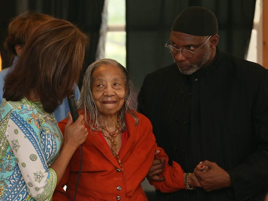 Courtney Greene chats with Willie Stevenson Glanton, Iowa's first African-American female legislator, who was honored at Fort Des Moines Museum Sept. 21, 2014. Glanton stands with State Representative Ako Abdul Samad.