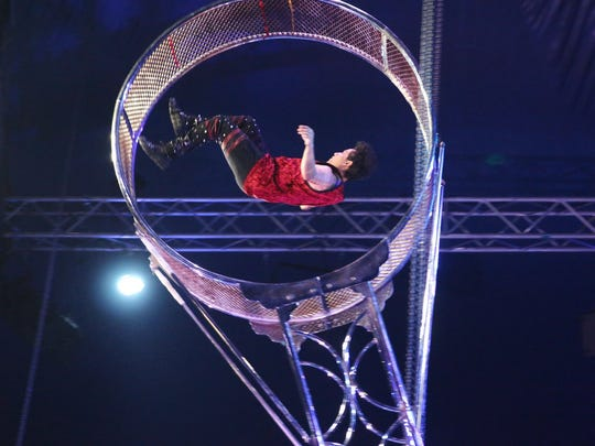 "Alberto Parrera in the ""Wheel of Death"" at Cirque Italia's ""Water Circus."""