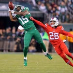 New York Jets wide receiver Brandon Marshall (15) drops a pass while defended by Buffalo Bills corner back Ronald Darby (28) during the fourth quarter at MetLife Stadium. The Bills defeated the Jets 22-17.
