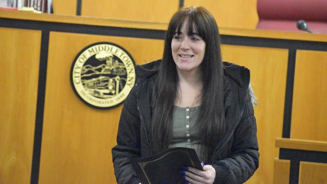 Elizabeth Steinman, 26, accepts her drug-court graduation certificate Tuesday morning in Middletown. She said she is more than 500 days sober.
