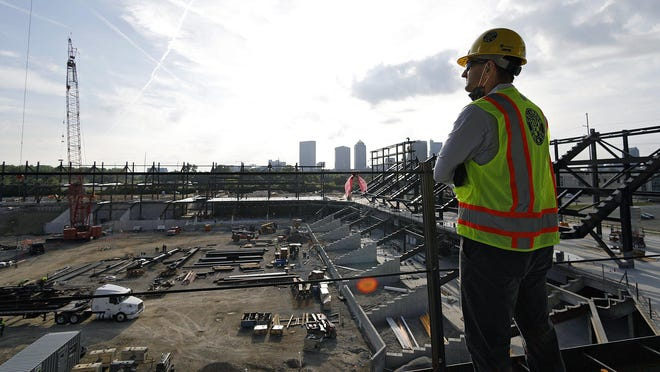 Crew president and general manager Tim Bezbatchenko takes a moment to look at the construction progress of the new stadium site during a tour on Wednesday.