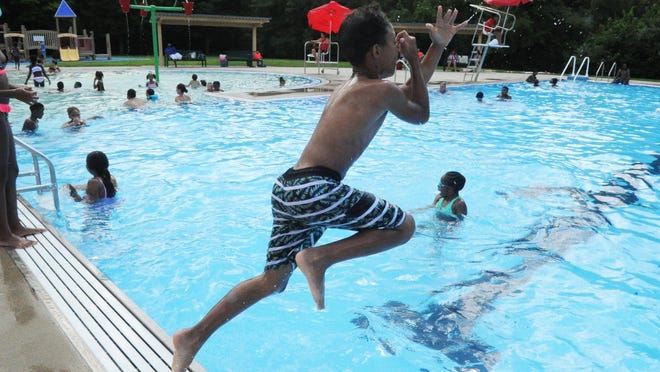 Kids cool off at the Manning Pool in Brockton in this Enterprise file photo from Aug. 9, 2018.