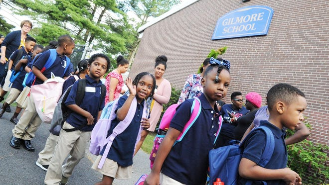 Students arrive for the first day of school at Gilmore Elementary School in Brockton in 2018.