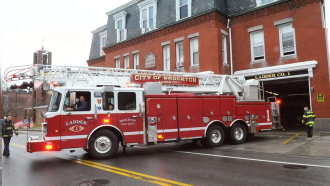 FILE - In this April 4, 2018, file photo, a Brockton Fire Department ladder truck is seen entering the fire station.