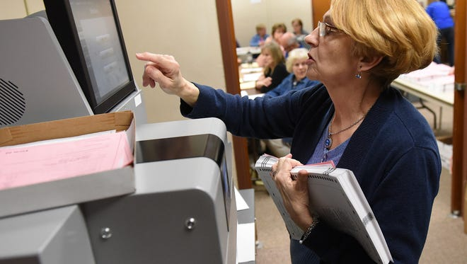 Mary Zeeb with the Minnehaha County Auditors Office uses a computer that scans the ballots and tallies the votes on election night, Tuesday, April 12, 2016.