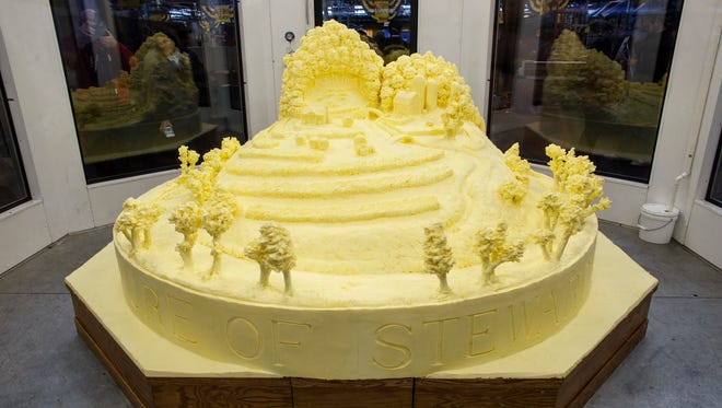 The butter sculpture is unveiled at the 101st Pennsylvania Farm Show in Harrisburg, Thursday. The sculpture, made from more than 1,000 pounds of butter, pays tribute to the history of environmental stewardship by dairy farmers.