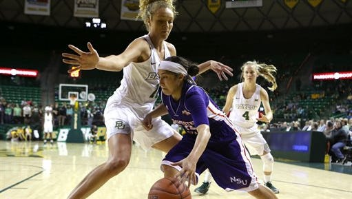 Northwestern State guard Janelle Perez (14) drives past Baylor forward Justis Szczepanski (11) in the second half of Friday's game.