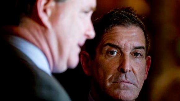 Independent Democratic Conference Leader Jeff Klein, D-Bronx, listens as Senate Majority Leader John Flanagan, R-Smithtown, talks to media members outside Gov. Andrew Cuomo's office at the state Capitol, Tuesday, March 29, 2016,