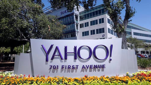 FILE - In this July 19, 2016, file photo, flowers bloom in front of a Yahoo sign at the company's headquarters in Sunnyvale, Calif. Yahoo detected evidence that a hacker had broken into its computer network at least 18 months before launching an investigation that discovered personal information had been stolen from about 500 million user accounts. The timeline outlined in a regulatory filing late Wednesday, Nov. 9, 2016, raises further questions about why it took Yahoo so long to realize the severity of its security breakdown. It could also jeopardize a $4.8 billion deal with Verizon.