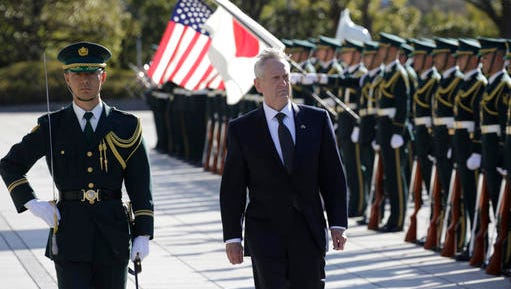 U.S. Defense Secretary Jim Mattis, right, is escorted to inspect an honor guard at Defense Ministry in Tokyo, Saturday, Feb. 4, 2017. Mattis on Friday reassured two key U.S. treaty allies, South Korea and Japan, that President Donald Trump, who has raised doubts about the value of such partnerships, is fully committed to defending them.