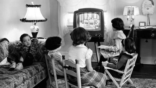 FILE - In this Jan. 6, 1953, file photo, four children watch a television in Baltimore, Md. Ever since freckle-faced puppet Howdy Doody ushered in children's television nearly 70 years ago, each new generation of viewers has been treated to a growing bounty of programs on a mushrooming selection of gadgetry. Even so, it may be surprising that youngsters watch most television on a television. Just as their elders mostly still do, and always did, since TV first began.