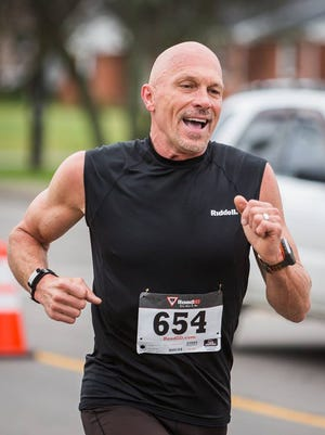 After taking up running five years ago, David Schmanski now holds several Tennessee Senior Olympics records. In this photo, he is participating in the Gallatin Shamrock Run 5K in March.