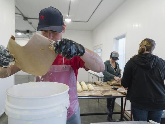 Ed Case salting the butter while Alex Fetherolf and