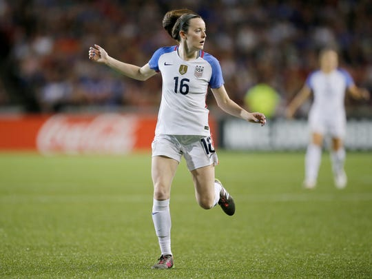 United States defender Rose Lavelle (16) runs into