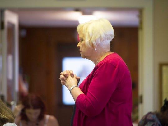 The Rev. Rebekah Fetzer leads a prayer before lunch