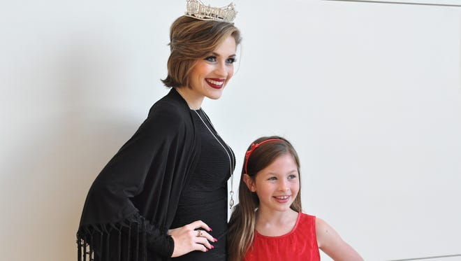 Miss America Betty Cantrell poses with Brooke Hollingsworth, 9, Tuesday during her visit to Christus St. Frances Cabrini Hospital.
