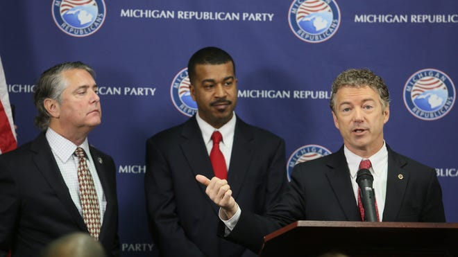 Sen. Rand Paul, right, with the support and backing of Michigan Republican Party Chairman Bobby Schostak, left, and RNC Michigan State Director of African-American Engagement  Wayne Bradley at the opening of the new Detroit office for the Michigan Republican Party in Detroit on Dec. 6.