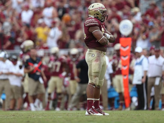 FSU's DeMarcus Walker strikes a pose after getting a sack during their homecoming game against Wake Forest at Doak Campbell Stadium.