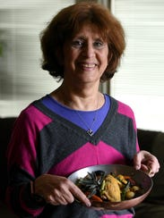 Barbara James holds chicken pot au feu she cook with