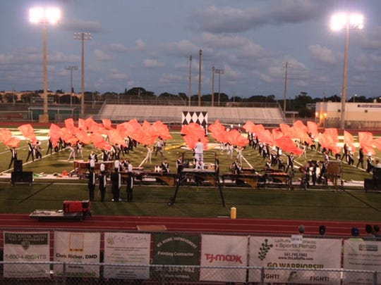 "The Spirit of Jupiter marching band performs its 2015 State Championship show ""Harlequin"" at the first Jupiter Festival of Bands at Jupiter High School on Oct. 31, 2015."