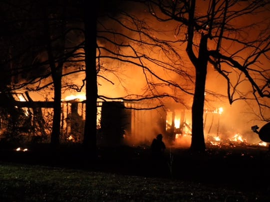 An early Sunday morning fire destroyed a house at 210