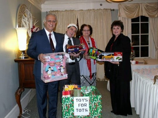 From left: UNICO Board Members Mike Marinaccio, Richard Wahila, Connie Cardullo and Jean Desio present toys to be donated to Toys for Tots.